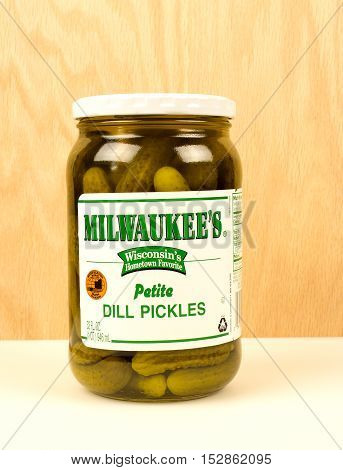 RIVER FALLS,WISCONSIN-OCTOBER 22,2016: A jar of Milwaukee brand petite dill pickles with a wood background.