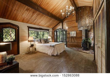 Wooden Bedroom Interior With High Vaulted Ceiling