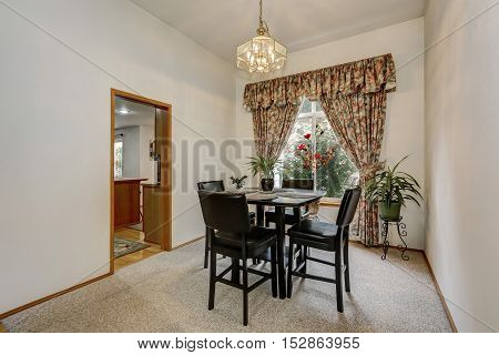 Cozy And Elegant Dining Room With Black Wooden Table Set