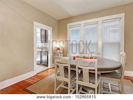 Bright Beige Dining Room With Vintage Furniture