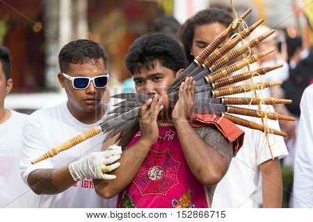 Phuket Town, THAILAND, October 07, 2016 : Devotee extreme piercing street procession during the Taoist vegetarian festival of the Nine Emperor Gods in Phuket, Thailand .