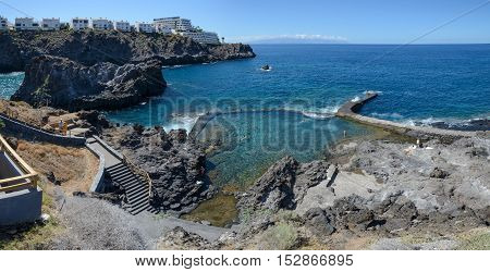 LOS GIGANTES, CANARY ISLANDS, SPAIN - OCTOBER 07: Tourists are visiting unusual beach like natural pool separated from sea on October 07, 2014 in Los Gigantes on Tenerife Island, Canary Islands, Spain.