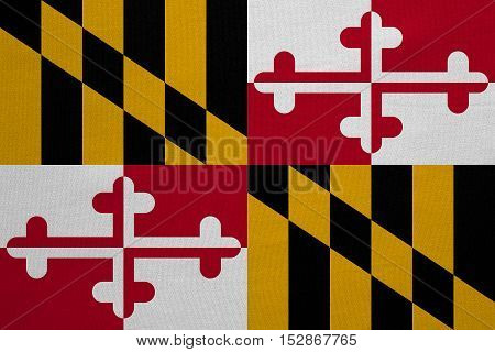 Flag of the US state of Maryland. American patriotic element. USA banner. United States of America symbol. Maryland official flag with real detailed fabric texture illustration. Accurate size colors