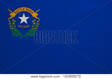 Flag of the US state of Nevada. American patriotic element. USA banner. United States of America symbol. Nevadan official flag with real detailed fabric texture illustration. Accurate size colors