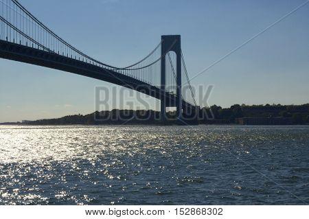 Verrazano Narrows Bridge spanning calm water at twilight