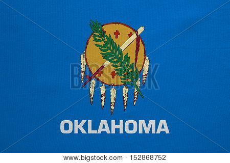 Flag of the US state of Oklahoma. American patriotic element. USA banner. United States of America symbol. Oklahoman official flag with real detailed fabric texture illustration. Accurate size color