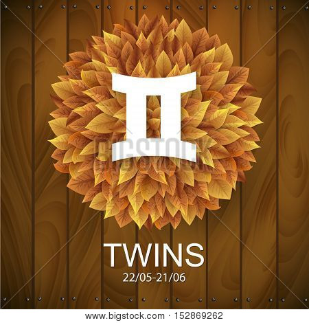 Sign of the zodiac. Twins horoscope. white sign with a circle of autumn leaves. Wooden planks background.