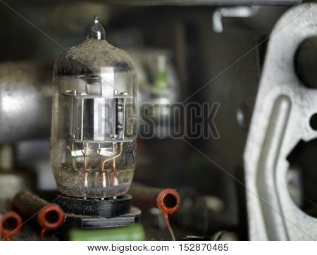 Macro shot pf a vacuum tube inside the old receiver shallow depth of field