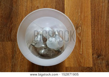 Inefficient Tungsten Light Bulbs Discarded In A Trash Can - Environmental Concept