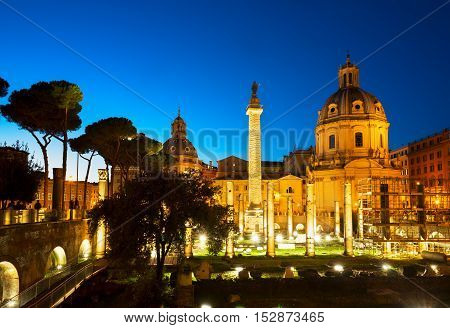 Forum - Roman ruins with column of Trajan in Rome illuminated at night, Italy