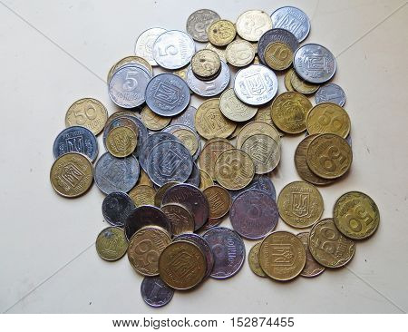 Heap of the ukrainian coins as a background