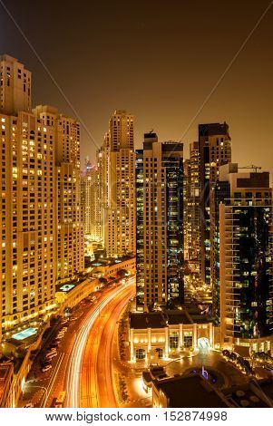 DUBAI, UAE - OCTOBER 07, 2016: A night shot of the popular Jumeirah Beach Residence (JBR) in Dubai Marina showing light trails of moving cars