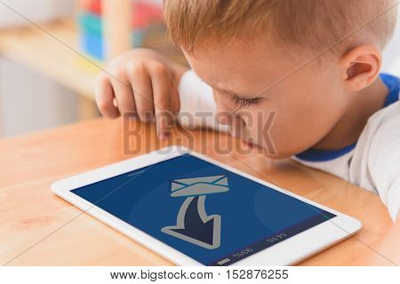 Message to my friend. Close up photo of little boy using digital tablet while sending message