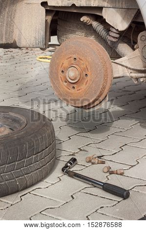 Changing tires or wheel before winter or spring. Preparing the car for the winter. Repair cracked tires.