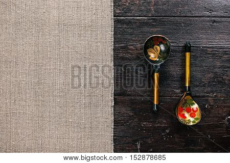 Still life with Russian traditional painted spoons on the half covered table. Flat lay