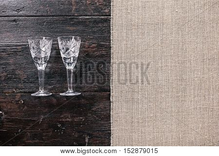 Still life with two empty wineglasses on the half covered table. Flat lay