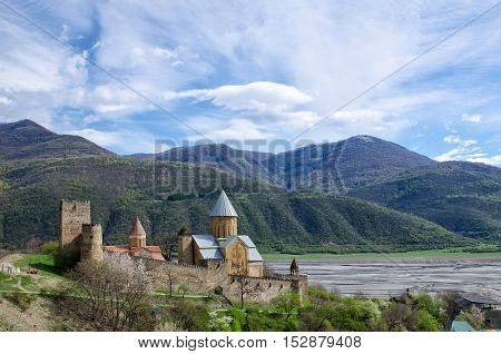 Old fortress on the shore against the backdrop of the mountains a beautiful spring sky Ananuri