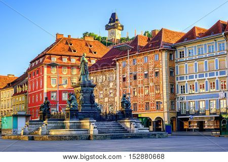 Painted facades and the Clocktower in the old town of Graz Austria are on UNESCO World Cultural Heritage list