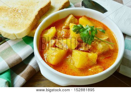 Chicken Mussaman Curry  (Thai food menu) with toast.
