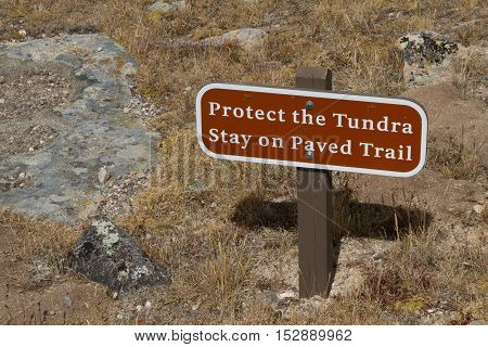 Protect the Tundra Stay on Paved Train warning sign in Rocky Mountan national Park