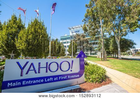 Sunnyvale, California, United States - August 15, 2016: Yahoo Headquarters with American Flag and flag with Yahoo icon on background.