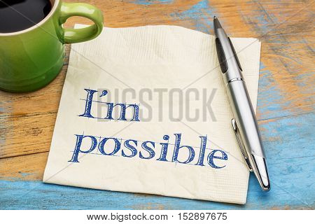 I'm possible - handwriting on a napkin with a cup of coffee