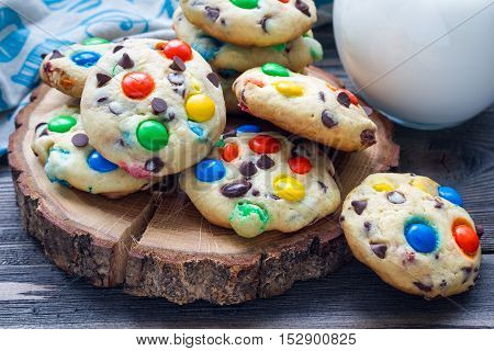 Shortbread cookies with multi-colored candy and chocolate chips on wooden board horizontal