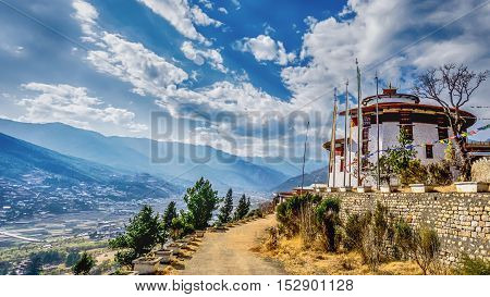 Mountain Village with rural road on a Sunny Summer day Bhutan
