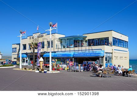 WEYMOUTH, UNITED KINGDOM - JULY 18, 2016 - View of the Pier Bandstand along the Esplanade with a pavement cafe in the foreground Weymouth Dorset England UK Western Europe, July 18, 2016.