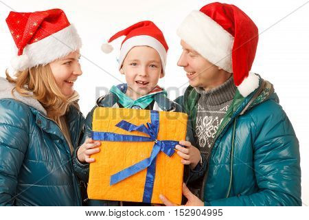 Happy FatherMother and Son on the White BackgroundDressed in Santa Hats with Present BoxClose-up
