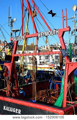 WEYMOUTH, UNITED KINGDOM - JULY 19, 2016 - Rear view of a fishing trawler in the harbour Weymouth Dorset England UK Western Europe, July 9, 2016.