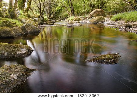 River glencree slowly flowing displaying beautiful reflections in the water