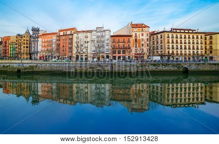 Bilbao, Basque Country - January 2015, Spain: Colored houses reflecting in water of River