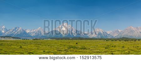 The amazing Teton mountains above Jackson Lake in Wyoming USA. - panorama image