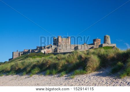 Bamburgh Castle in Northumberland viewed from the sand dunes
