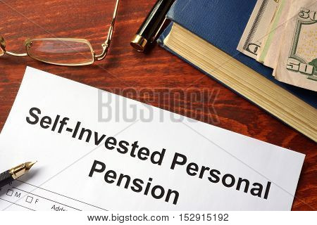 Self-Invested Personal Pension (SIPP) form on an office table.