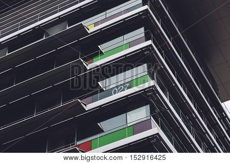 Abstract modern office building. Dark mood. Low angle view