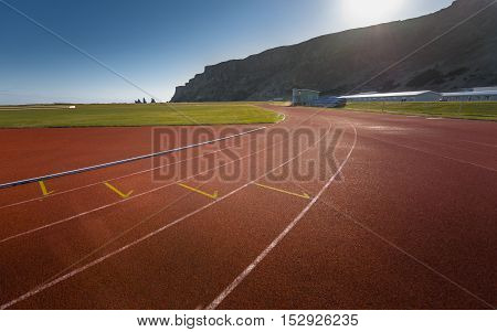 Photo of running track outdoors with beautiful nature