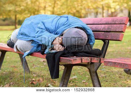 Homeless Elderly Woman Sleeping Rough In A Park