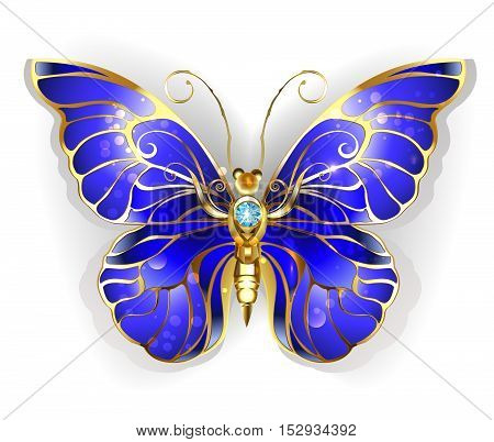 Luxury Jewelry gold butterfly with dark blue sapphire wings on a white background. Golden Butterfly Morpho.