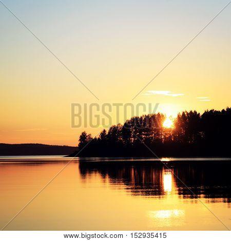Sunset at Kenozero lake. Beautiful northern landscape. Aged photo. Wild nature of Russian North. Vintage photo. Kenozersky National Park (UNESCO Biosphere Reserve) Russia.