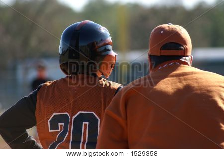 Baseball Player With Base Coach