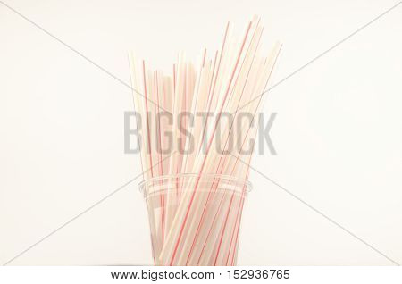 Striped straws for a cocktail stand in a plastic cup