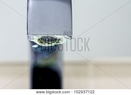close up on limestone deposit on a tap poster