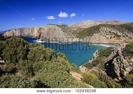 View from above on the sea and the mountains on the beach Cala Domestica in Sardinia Italy.