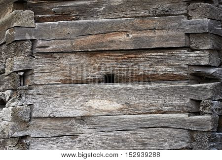 A fragment of a wall made of wooden logs. Texture background