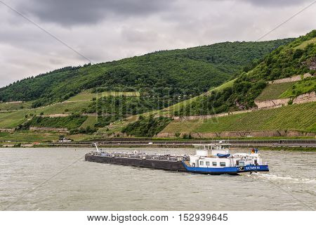 Trechtingshausen Germany - May 23 2016: Tanker Eiltank 65 on the Rhine River near Trechtingshausen in cloudy weather Rhine Valley UNESCO World Heritage Site Rhineland-Palatinate Germany.