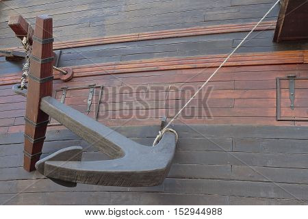 hull of an ancient warship with anchor on foreground