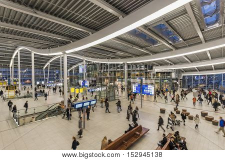 Utrecht The Netherlands - October 12 2016: Central hall of NS Central Railway Station Utrecht with walking and waiting people The Netherlands.
