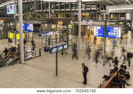 Utrecht The Netherlands - October 12 2016: Central hall of NS Central Railway Station Utrecht with walking and waiting people in the Netherlands.